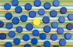 Tampas plásticas, uma em uma cor diferente Imagem de Stock Royalty Free
