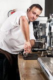 Tamper and barista Stock Image