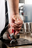 Tamper and barista Stock Photography