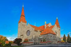 The Tampere cathedral. Medieval Tampere cathedral in Finland (Finnish Tampereen tuomiokirkko, Swedish Tammerfors domkyrka) is a church in Tampere, Finland and Stock Photos