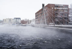 TAMPERE, FINLAND - JAN 2016. Cold and cloudy winter day next to Tammerkoski. Stock Photo