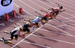Athletes on the start of the 110 meters hurdles on IAAF World U20 Championship in Tampere, Finland 11 July, 2018. royalty free stock photo