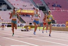 Jarmillia MURPHY-KNIGHT, Viivi LEHIKOINEN, Ruta OKULIC-KAZARINAITÄ– running 400 metres hurdles in the IAAF World U20 Championship royalty free stock image