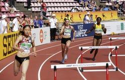 KASUMI YOSHIDA, MEGAN CHAMPOUX, SHIANN SALMON running 400 metres hurdles in the IAAF World U20 Championship in Tampere, Finland royalty free stock photos