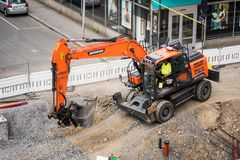 Tampere tramline construction- Doosan excavator digging Stock Photos