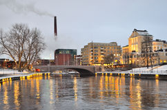 Tampere at  twilight. Tampere, Finland. River Tammerkoski embankments at winter twilight Royalty Free Stock Images