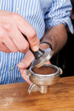 Tamping the coffee Royalty Free Stock Image