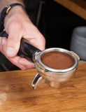 Tamping the coffee Royalty Free Stock Photo