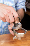 Tamping the coffee Royalty Free Stock Photos