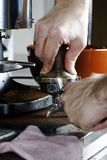 Tamping Espresso. Tamping the espresso after dosing and leveling Royalty Free Stock Images