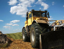 Tamping silage. Fodder for livestock in industrial scale Royalty Free Stock Photography