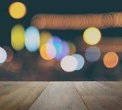 Tampo da mesa de Ood no fundo abstrato com luzes defocused do bokeh Imagem de Stock Royalty Free