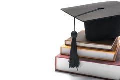 Tampão e livro da graduação Fotografia de Stock
