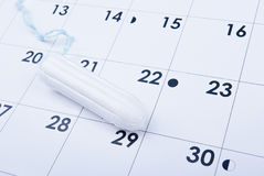 Tampon on calendar. Tampon lying on the calendar close up Royalty Free Stock Photography