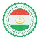 Tampon en caoutchouc grunge avec le drapeau du Tadjikistan Photographie stock libre de droits