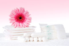 Tampons and pads. Health care and medicine - tampons and pads on pink background Royalty Free Stock Images