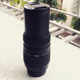 Tamron 70-300mm telephoto lens for Nikon. A photograph of a Tamron telephoto lens with Nikon mount Stock Photography