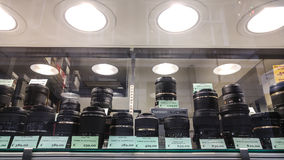 Tamron and Sigma. N brand professional and amateur grade lenses on a window store display.  Third party lens produced for Nikon cameras and also for Canon brand Royalty Free Stock Images