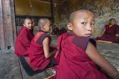 Novice monks of Tamshing Goemba , Bumthang valley , Bhutan. Tamshing Goemba was established in 1501 and is the most important Nyingma goemba in the kingdom royalty free stock photo