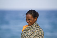 Tamul old woman from Sri Lanka smiling in the beach Stock Photos