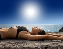 Tan. Portrait of attractive woman tanning Royalty Free Stock Photo