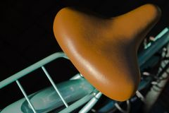 Cruiser. Tan bicycle saddle detail on turquoise bicycle in sunlight Stock Photography