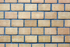Tan bricks in a wall Stock Images
