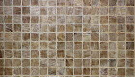 Tan and Brown Ceramic Tile Background. A background shot shows tan and brown tiles Stock Photography
