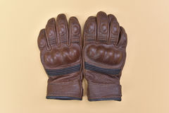 Tan brown leather gloves for riding a motorcycle or bicycle Royalty Free Stock Images