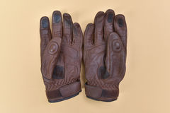 Tan brown leather gloves for riding a motorcycle or bicycle Royalty Free Stock Image