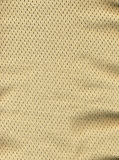 Tan/Brown Mesh Fabric. Macro of tan/brown mesh fabric with tiny holes Royalty Free Stock Image