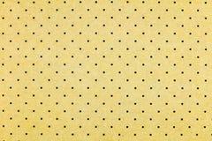 Tan cardboard square black dots background Royalty Free Stock Photo