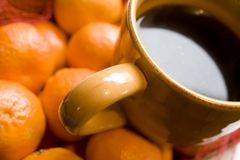 Tan Coffee Cup on Orange Background Royalty Free Stock Images