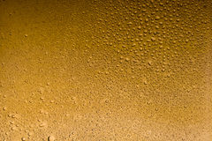 Tan color water drops abstract background. Texture stock photo