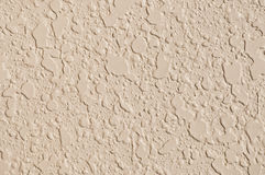 Tan colored wall texture Stock Images