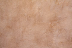 Tan concrete wall background Royalty Free Stock Images
