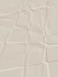 Tan Creased Paper. Neutral tan paper with texture, creases and wrinkles Royalty Free Stock Image