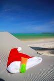 Tan del sombrero y de sol de Santa en el sillón Fotografía de archivo