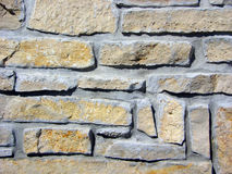 Tan Flagstone Wall. Flagstone wall close-up with tan rocks and gray mortar Stock Photos