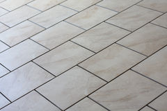 Tan floor tiles Stock Photography