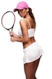 Tan-Frau in der weißen Sportkleidung und im Tennisschläger Stockfoto