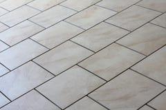 Tan-Fußbodenfliesen Stockfotografie