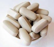 Tan Generic Drugs. Tan generic pills on a bottle cap royalty free stock image