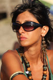 Tan girl accessories with sunglasses Royalty Free Stock Image