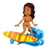 A tan girl surfing Stock Images