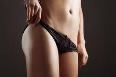Tan girl waist Royalty Free Stock Images