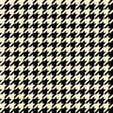 Tan Houndstooth Pattern. Black and tan colored seamless houndstooth pattern or texture Royalty Free Stock Images