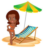 A tan lady at the beach Royalty Free Stock Image