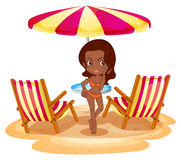 A tan lady at the beach near the beach umbrella and chairs Stock Images