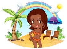 A tan lady in an orange bikini at the beach Stock Photography